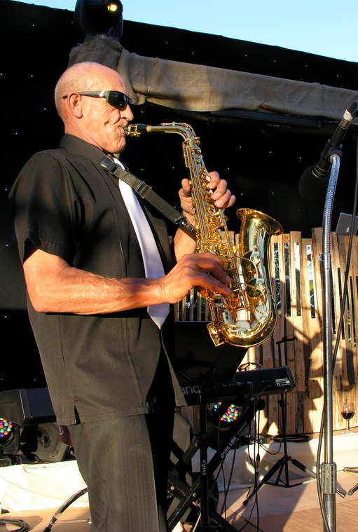 top wedding singer Ike Moriz saxophonist Willie van Zyl on stage Rozendal with DJ Miss Creamer