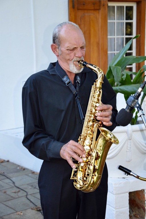 Willie van Zyl on saxophone, performing at the cocktail hour pre-drinks of Nicole and Michael's wedding at Montpellier de Tulbagh live music one man band top wedding singer