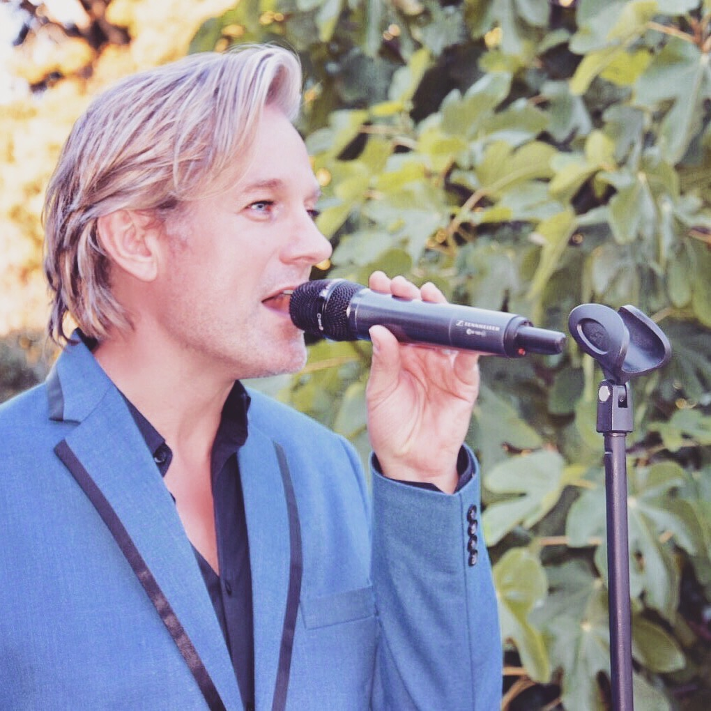 Ike Moriz solo performance at The Forum - Embassy Hill Constantia 11.11.17 November 2017 swing jazz reception wedding band entertainment solo vocalist singer crooner top sing neda farshad southern cross drive garden reception pre drinks cocktails ceremony cape town south africa swing jazz latin pop easy listening blonde blue suit