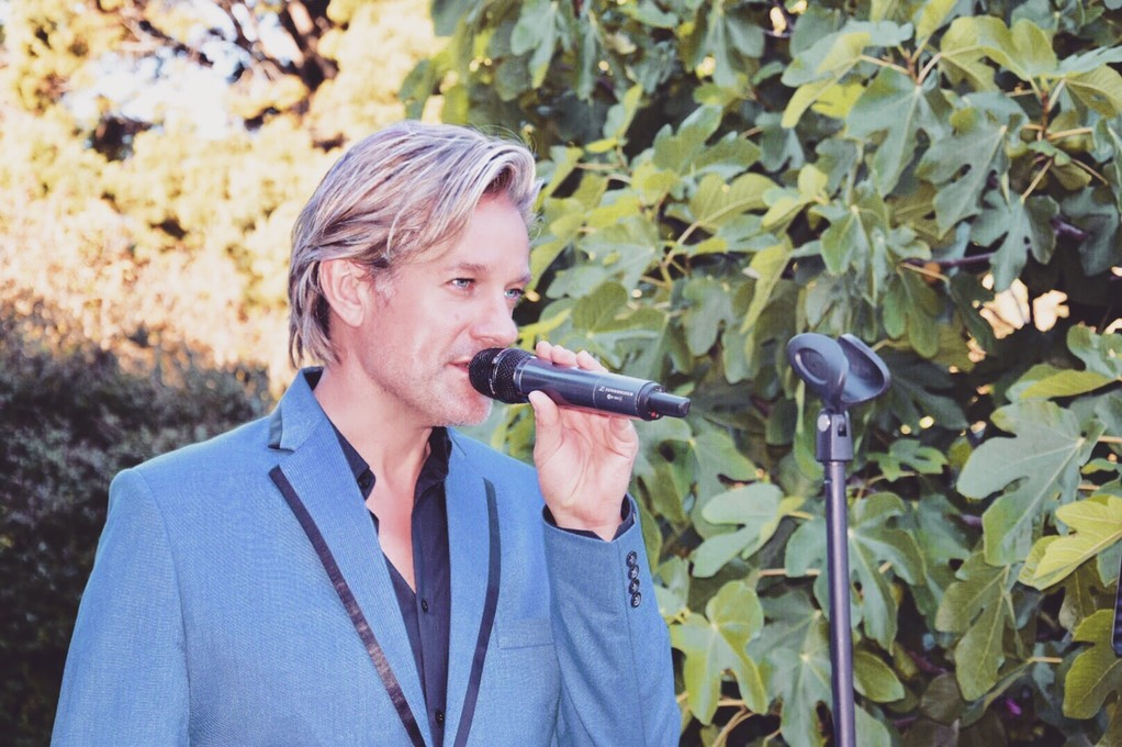 Ike Moriz solo performance at The Forum - Embassy Hill Constantia 11.11.17 November 2017 swing jazz reception wedding band entertainment solo vocalist singer crooner top sing neda farshad southern cross drive garden reception pre drinks cocktails ceremony cape town south africa swing jazz latin pop easy listening blue suit black shirt