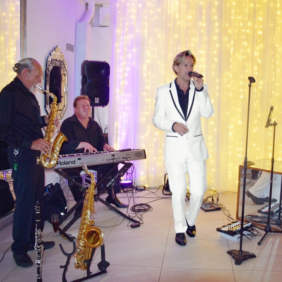 Ike Moriz Trio live at the 12 Apostles Hotel and Spa November 2017 wedding band entertainment reception dinner background music swing jazz latin pop singer crooner top willie van zyl andrew ford roland piano saxophone clarinet vocals fairy lights twelve safir opal camps bay ocean view