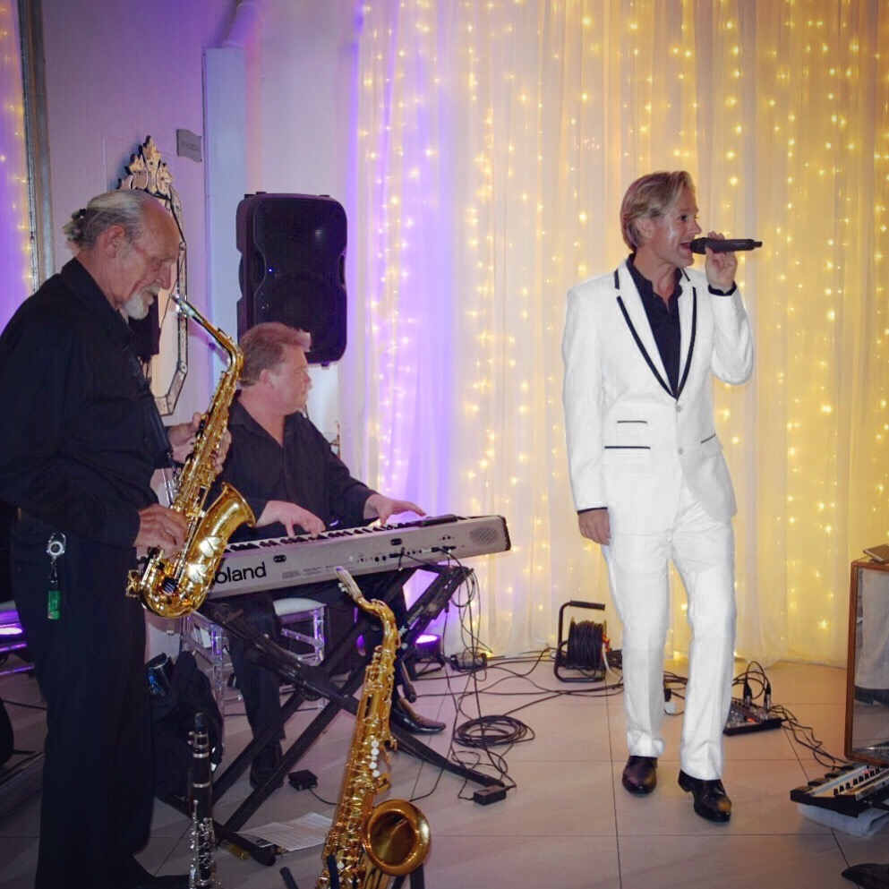 Ike Moriz Trio live at the 12 Apostles Hotel and Spa November 2017 wedding band entertainment reception dinner background music swing jazz latin pop singer crooner top willie van zyl andrew ford roland piano saxophone clarinet vocals fairy lights twelve safir opal camps bay ocean view standards singing