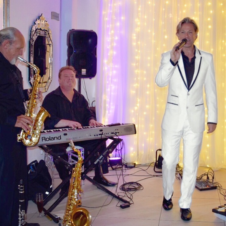 Ike Moriz Trio live at the 12 Apostles Hotel and Spa November 2017 wedding band entertainment reception dinner background music swing jazz latin pop singer crooner top willie van zyl andrew ford roland piano saxophone clarinet vocals fairy lights twelve safir opal camps bay ocean view white suit